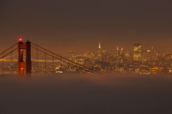 Downtown San Francisco above foggy Golden Gate