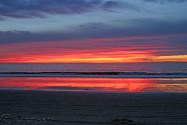 Red Skies reflect in Hermosa Beach, CA