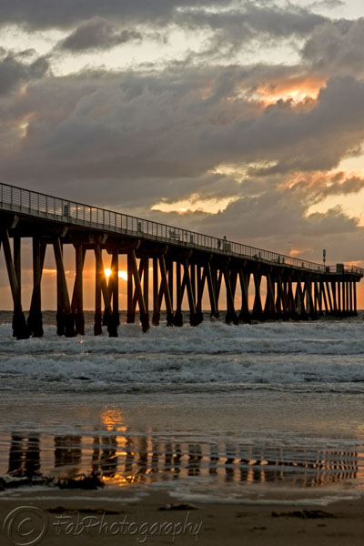 Sun Peaks through Pier in Hermosa Beach, CA